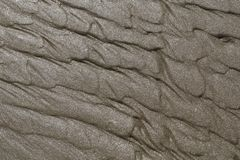 Wet sand reflecting the sunlight. A closeup of wet sand on the beach reflecting the sunlight Stock Photo