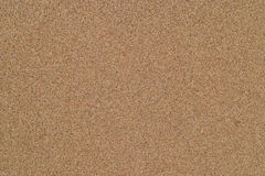 Wet sand on the sea coast. Smooth texture stock photography