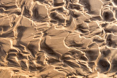 Wet sand texture Stock Images