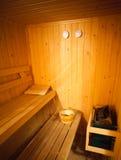 Wet sauna. Classic wooden wet sauna beds and oven Stock Photography