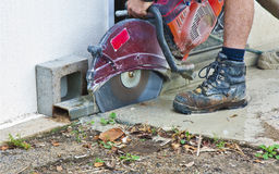 Wet saw cutting cement Royalty Free Stock Image