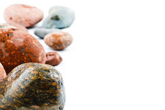 Wet sea stones isolated on white background Royalty Free Stock Photo