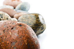 Wet sea stones isolated on white background Stock Photo