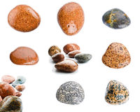 Wet sea stones isolated on white background. Set of sea stones. Royalty Free Stock Image