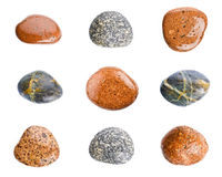 Wet sea stones isolated on white background. Set of sea stones. Royalty Free Stock Images