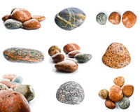 Wet sea stones isolated on white background. Set of sea stones. Stock Photos