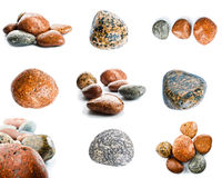 Wet sea stones isolated on white background. Set of sea stones. Stock Photo
