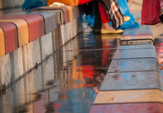Wet seats in the stands. Multicolored wet seats in the stands after a rain Royalty Free Stock Photo