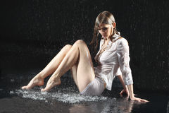 Wet sexy underwear girl seat on floor Royalty Free Stock Photos