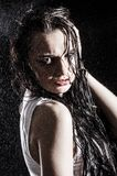 Wet sexy woman covered with water drops Stock Images