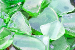 Wet Shards of Flat Green Beach Glass Royalty Free Stock Images