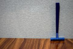 Wet shave razor on a wooden table stock photo