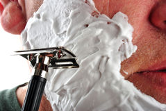 wet shaving razor and some foam in a face Stock Photos