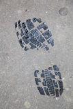 Wet shoe print on asphalt Royalty Free Stock Photography