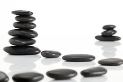 Wet smooth polished hot massage black stones Stock Image