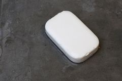 Wet Soap on Concrete Floor. Wet Soap with no bubble on Concrete Floor Stock Image