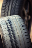 Wet sports rims and tire Stock Photos