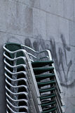 Wet stacked chairs Stock Image