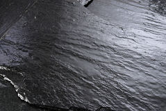 Wet stone. Wet black stone, great for background use Royalty Free Stock Image