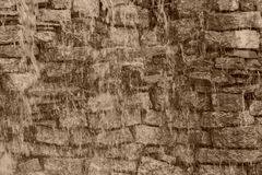 Wet stone brick wall of color sepia Stock Photo