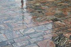 Wet Stone Pavement. Pavement wet in rainy weather royalty free stock photography