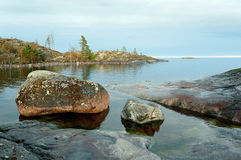 Wet stones. Stone coast of Ladoga lake after a rain Royalty Free Stock Photos
