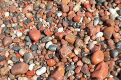 Wet Stones. Small wet stones by the sea. Abstract background Royalty Free Stock Photography
