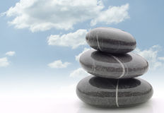 Wet stones in balanced pile stock photography