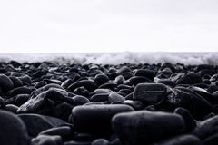 Wet stones on the beach Royalty Free Stock Photo