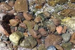 Wet stones on the beach. Royalty Free Stock Photos