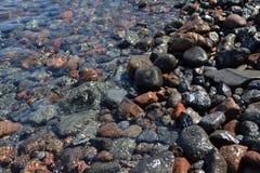 Wet stones Stock Images