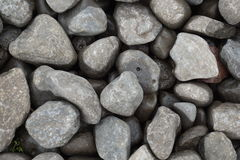 Wet Stones outside. Natural stones on the ground outside after rain Stock Photo