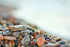 Wet stones on sea beach Stock Photo