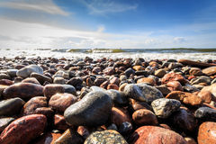 Wet stones and waves Royalty Free Stock Photo
