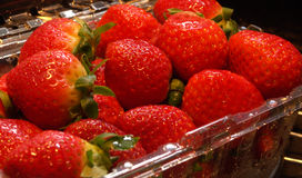 Wet Strawberries In A Clear Container Stock Photos