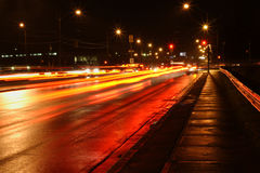 Wet street and abstract light trail royalty free stock photography