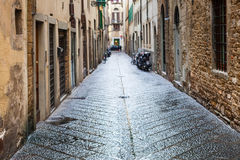 Wet street in residential district city in rain. Travel to Italy - wet street in old residential district of Florence city in autumn rain Stock Photography