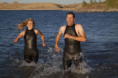 Wet suit running water Royalty Free Stock Photo