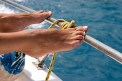 Wet  sunburned feet. A close-up view of a woman's sunburned feet Royalty Free Stock Photo