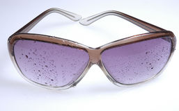 Wet sunglasses II. Wet sunglasses on white ground Royalty Free Stock Photography