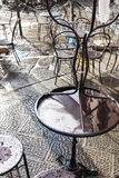 Wet tables in street cafe in Florence after rain Stock Photos