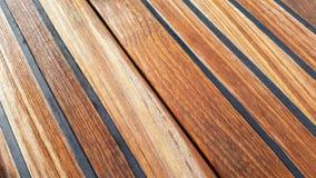 Wet teak deck wallpaper royalty free stock photos