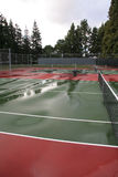 Wet tennis court after rain Royalty Free Stock Photography