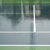Wet tennis court Stock Images
