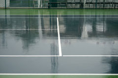 Wet tennis court Royalty Free Stock Photos