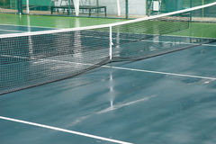 Wet tennis court Stock Photography