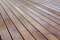 Wet terrace brown wood floor Stock Image