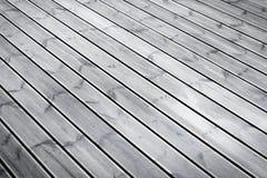 Wet terrace brown wood floor Stock Images