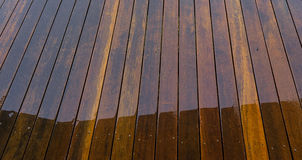 Wet timber floorboards background Stock Photos