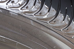Wet tire Stock Images